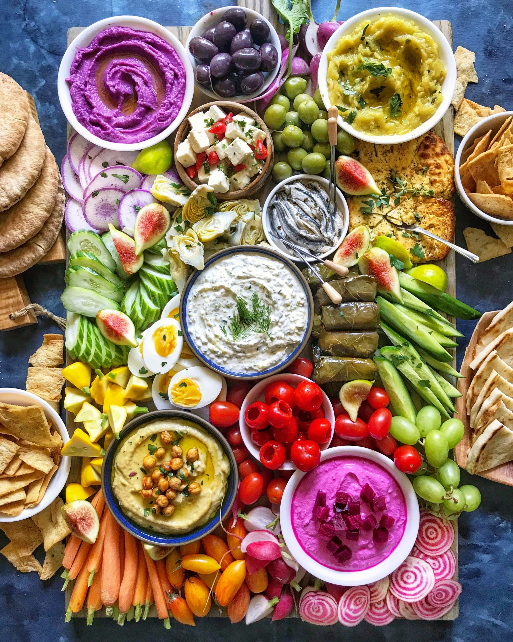 mediterranean mezze board with hummus, tzatziki and other dips
