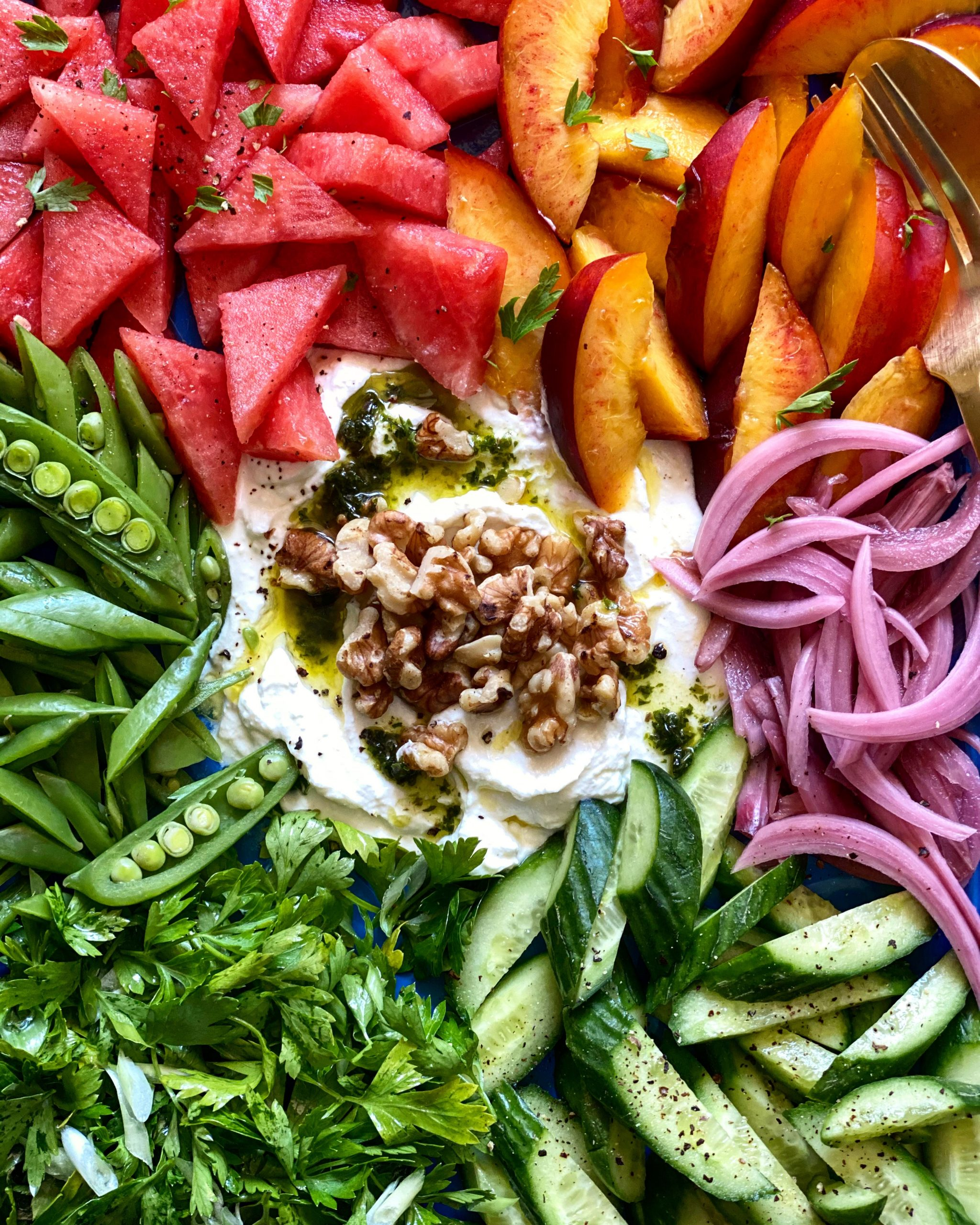 whipped feta dip with fruit, vegetables, and parsley salad